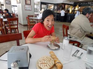 Photo of me enjoying coffee and pastries in Mexico
